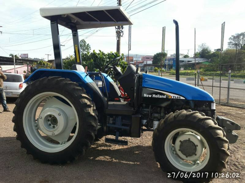 TRATOR NEW HOLLAND TL 65 - 4X4  (DIE 1213) ANO 2002- R$ 50.000,00